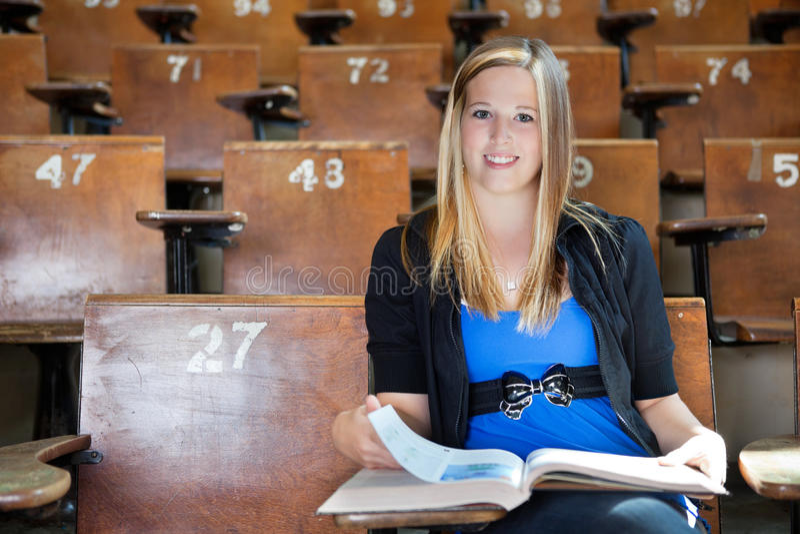 Girl studying at university hall stock photo