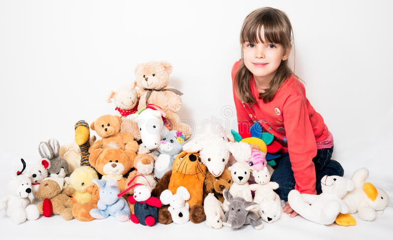 Girl with stuffed animals. On white background royalty free stock photo