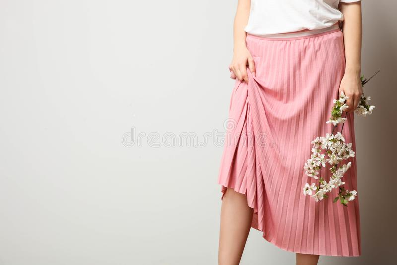 Girl in stylish fashionable pink skirt royalty free stock image