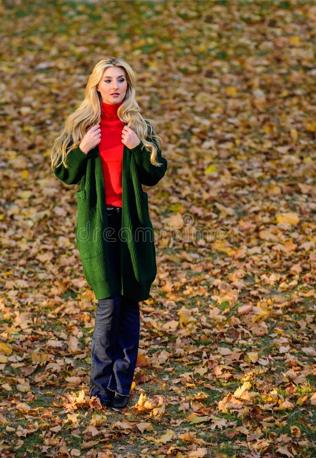 Girl stylish outfit with soft wool or cashmere cardigan. Feel so warm and comfortable. Woman wear long wool cardigan. While walk in park. Fall fashion warm stock photos