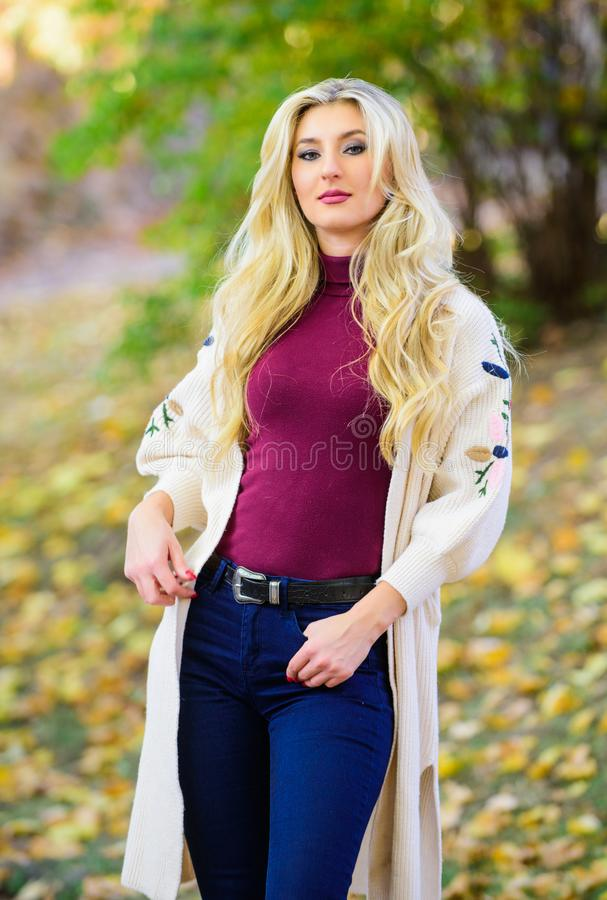 Girl stylish outfit with soft wool or cashmere cardigan. Woman wear long knitted cardigan while walk in park. Fall. Fashion cozy cardigan. Feel so warm and royalty free stock photography
