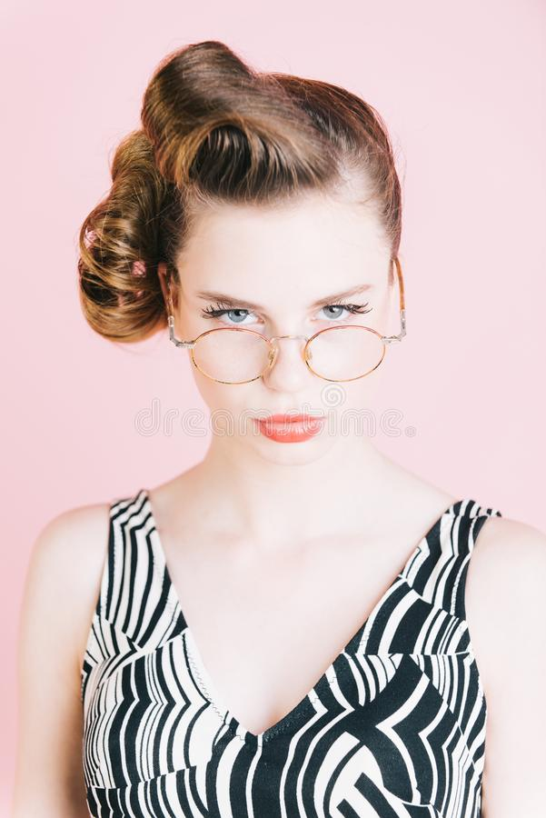 Girl in stylish vintage dress on pink. stock photography
