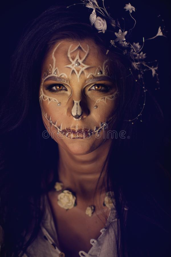 Girl with a stylized make-up of a dead bride stock photography