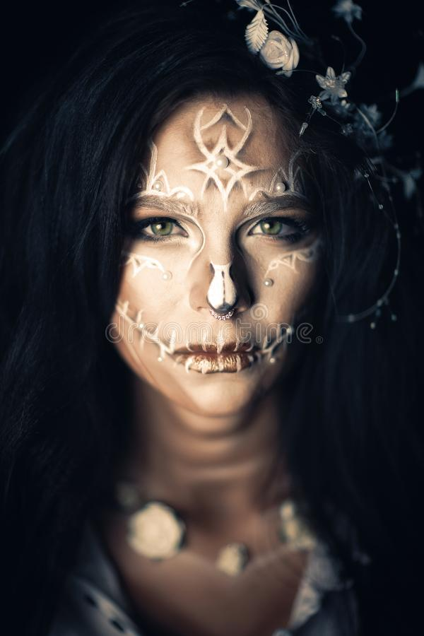Girl with a stylized make-up of a dead bride royalty free stock photo