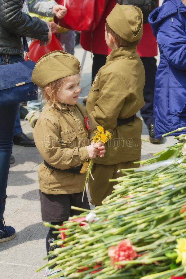 Girl in a stylized tunic on Victory day stock images