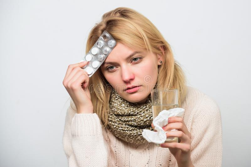 Girl suffer headache and take medicine. Headache and fever remedies. Woman tousled hair scarf hold tablets blister. Guidelines for treating fever. Take royalty free stock image