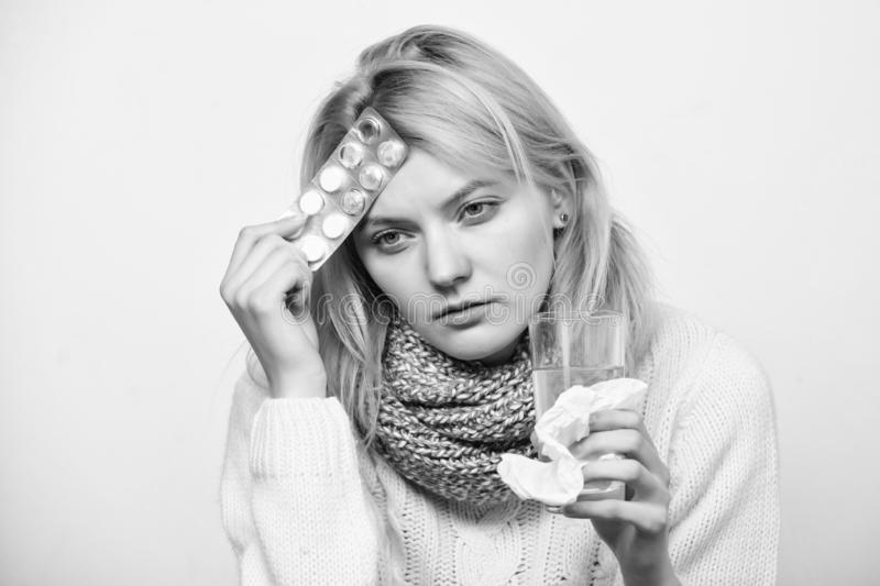 Girl suffer headache and take medicine. Headache and fever remedies. Woman tousled hair scarf hold tablets blister. Guidelines for treating fever. Take stock image