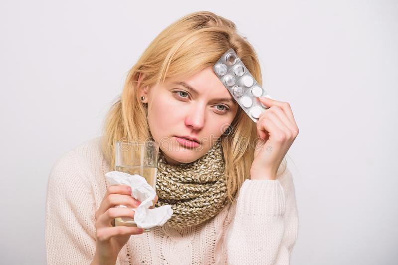 Girl suffer headache and take medicine. Headache and fever remedies. Woman tousled hair scarf hold tablets blister. Guidelines for treating fever. Take royalty free stock images