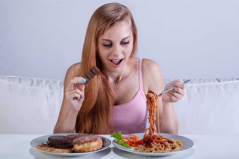 Girl suffering from bulimia eats dinner royalty free stock photo