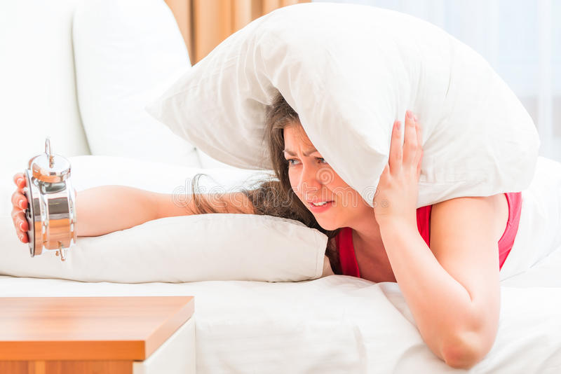 Girl suffering from insomnia. Young and beautiful girl suffering from insomnia stock images