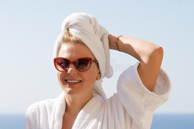 Girl in suglasses with towel on her head stock photography