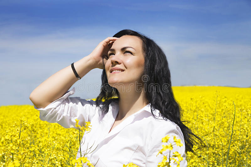 Girl in suit at the yellow flower field stock photo