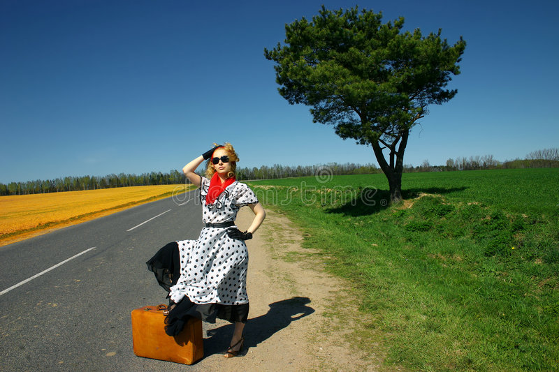 Girl with a suitcase royalty free stock image