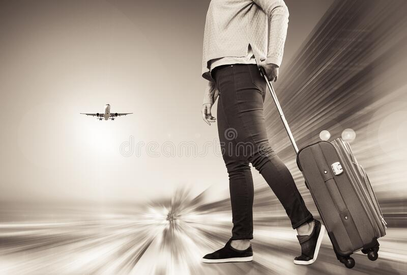 Girl with suitcase on wheels. Girl walking with suitcase on wheels before boarding to plane royalty free stock images