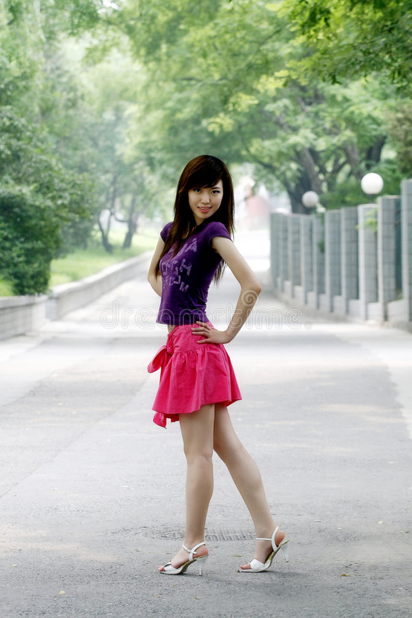 A girl in the summer. In the summer in June, a Asian girl is on the boulevard stock images