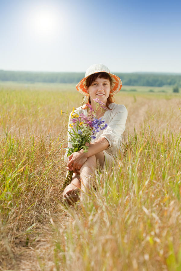 Girl in summer field stock photo