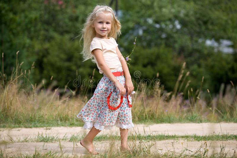 Girl with summer flowers royalty free stock photos