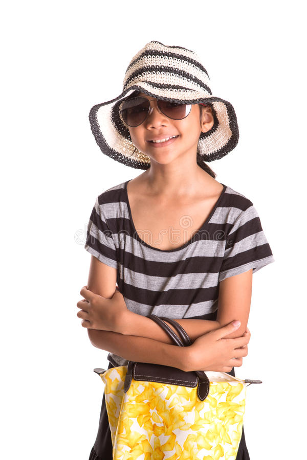 Girl With Summer Hat, Sunglasses And Handbag III. Young Asian Malay girl with a large summer hat, sunglasses and a yellow handbag over white background stock photos
