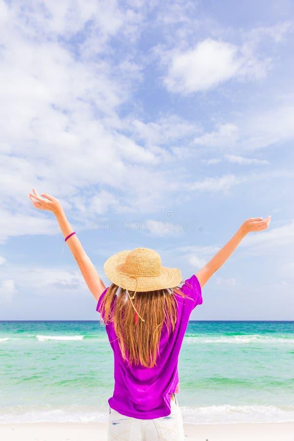 Girl on a summery beach royalty free stock photo