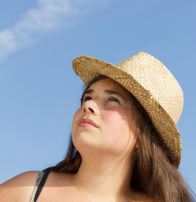 Girl with sun hat stock photo