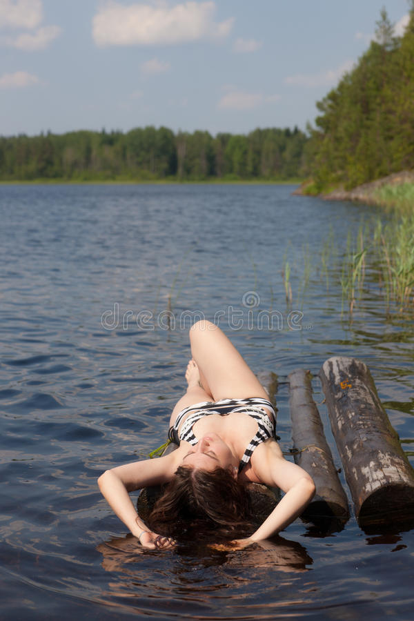 The Girl Sunbathes On A Raft Royalty Free Stock Photography