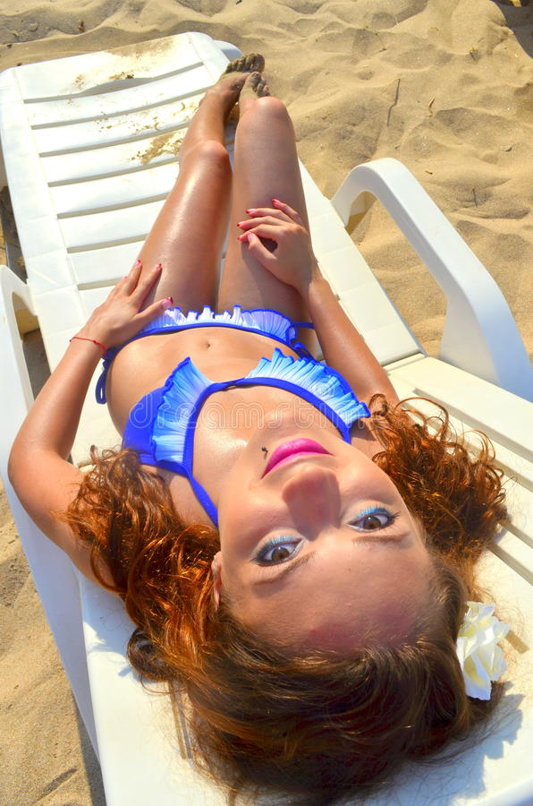 Girl sunbathing royalty free stock photos