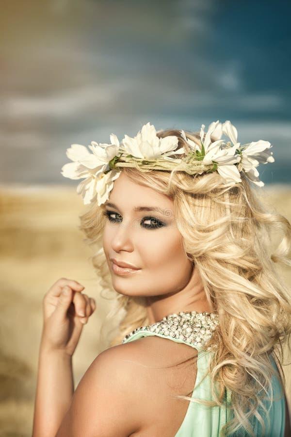 Girl, sunbeam, wreath stock photography