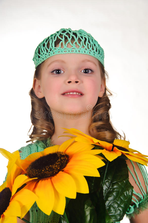 Girl with sunflowers royalty free stock photography