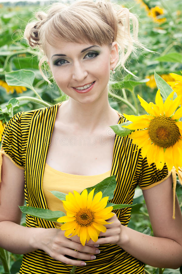Girl With A Sunflowers Royalty Free Stock Photos