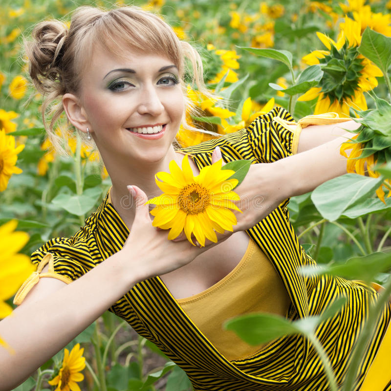 Download Girl with a sunflowers stock photo. Image of attractive - 23976718