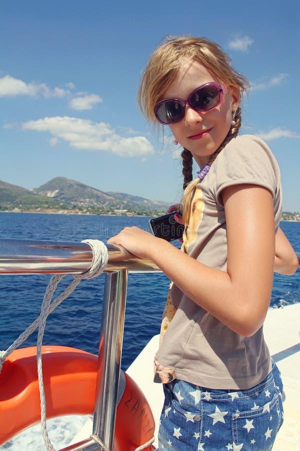 Girl in sunglasses on boat stock photo