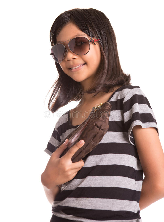 Girl With Sunglasses And Purse III. Young Asian girl with sunglasses and purse over white background royalty free stock photography
