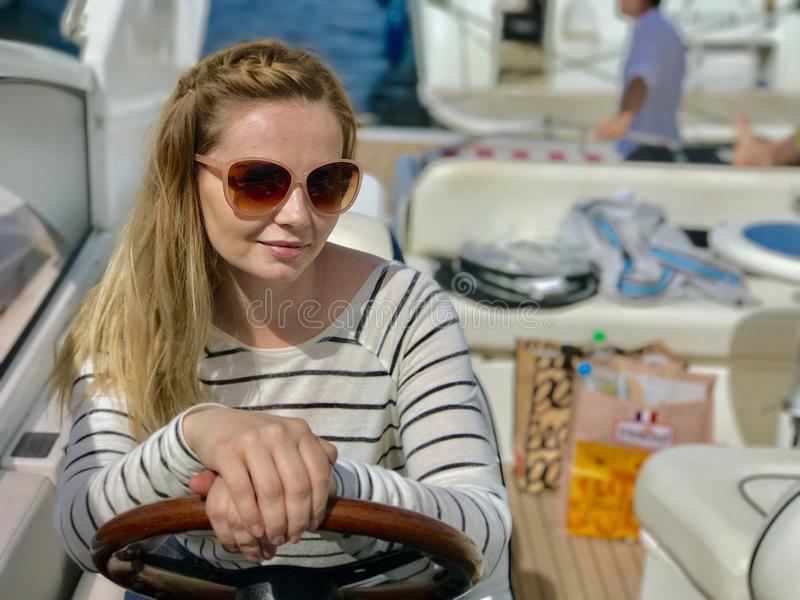 Girl in sunglasses travels on a yacht royalty free stock photo
