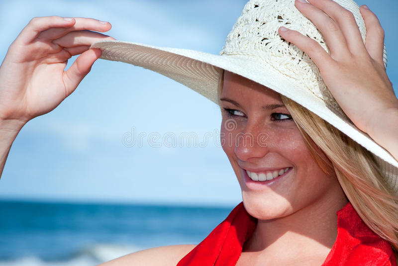 Girl in sunhat royalty free stock image