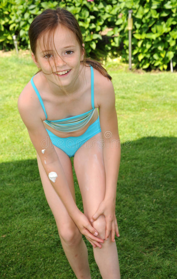 Girl and sunscreen stock images