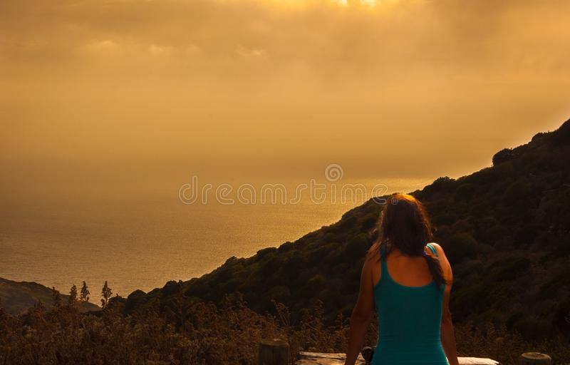 girl at sunset with landscape stock photo