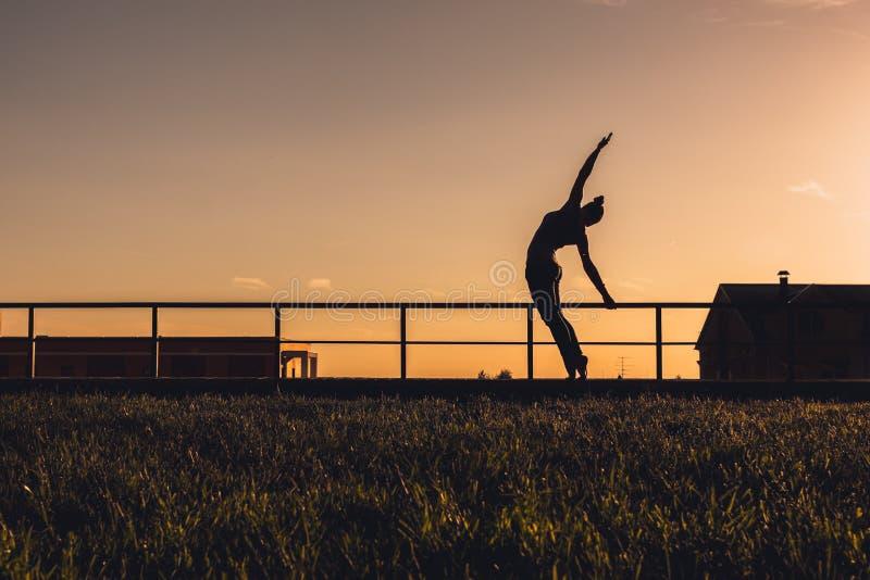 Girl sunset stock images