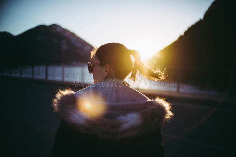 Girl at sunset stock photography