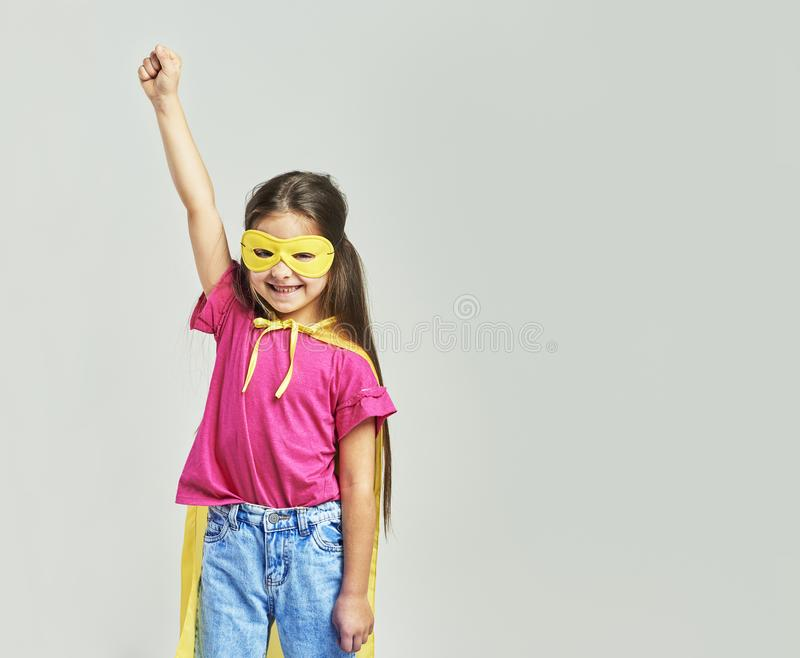 Girl in superhero costume stock photography
