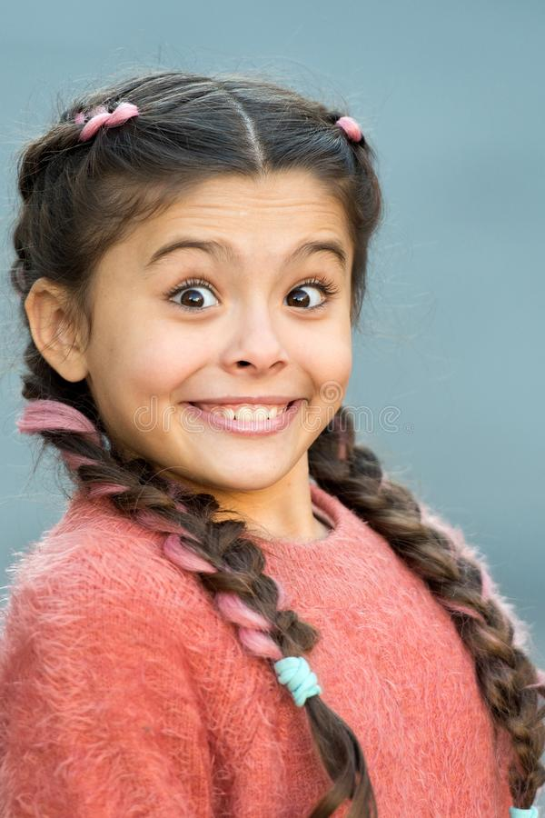 Girl surprised emotional face. What a surprising news. Childhood and happiness concept. Kid with surprised face and royalty free stock photography