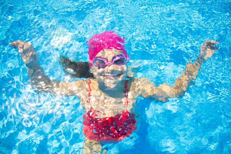 Girl swim in  pool royalty free stock photography