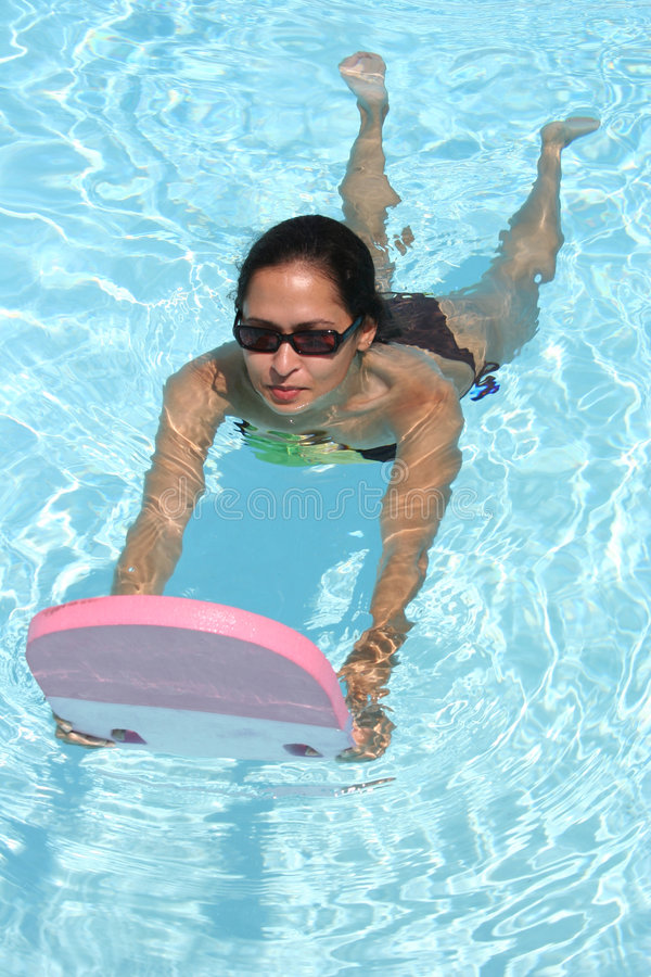 Girl swimming stock images