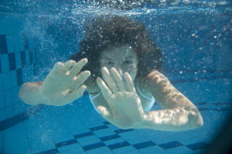 Girl swimming royalty free stock image