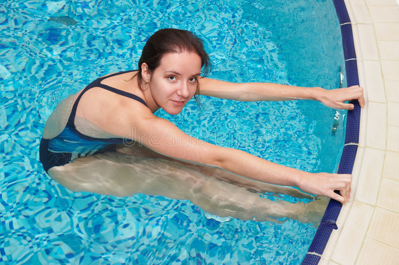 Girl swimming royalty free stock images