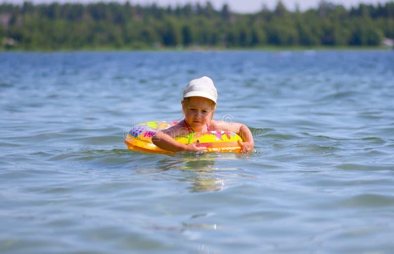 Girl swimming on the lake royalty free stock image