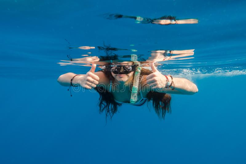 Girl in swimming mask dive in Red sea royalty free stock image