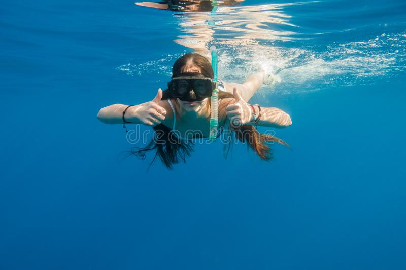 Girl in swimming mask dive in Red sea stock photos