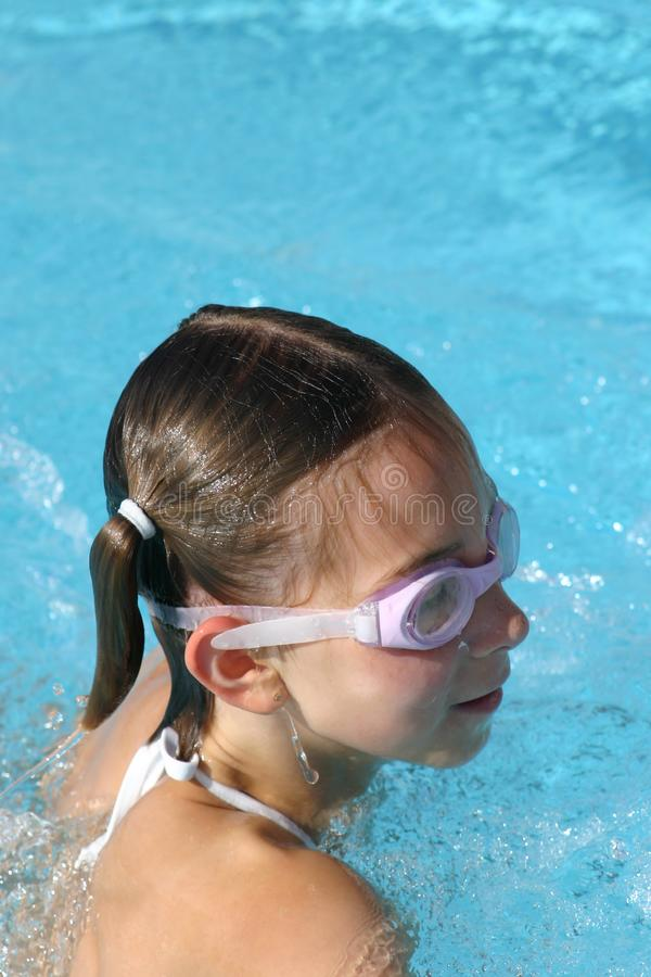 Girl swimming in the pool royalty free stock photography