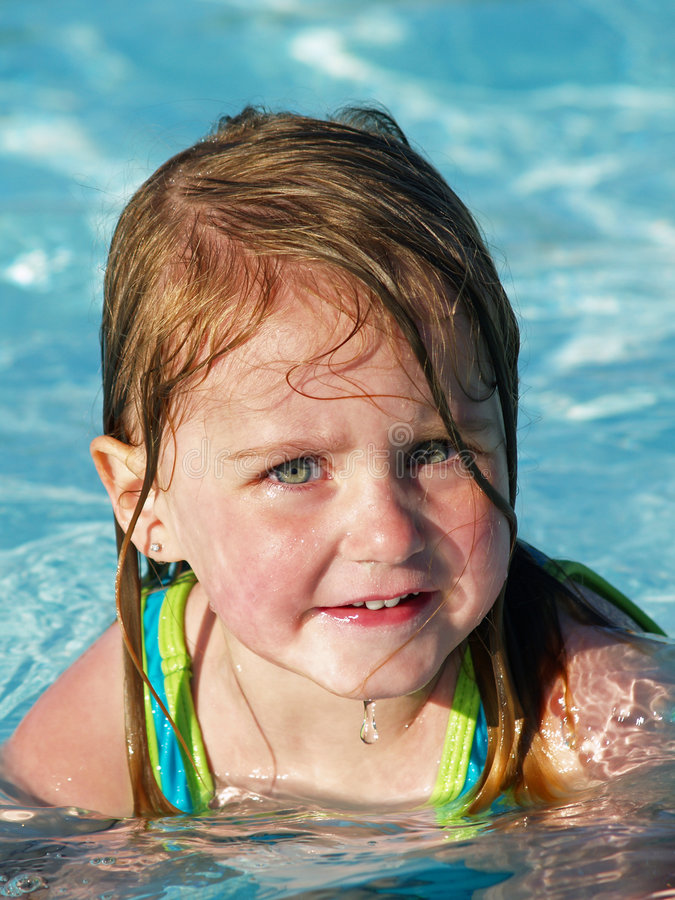 Girl in swimming pool stock images