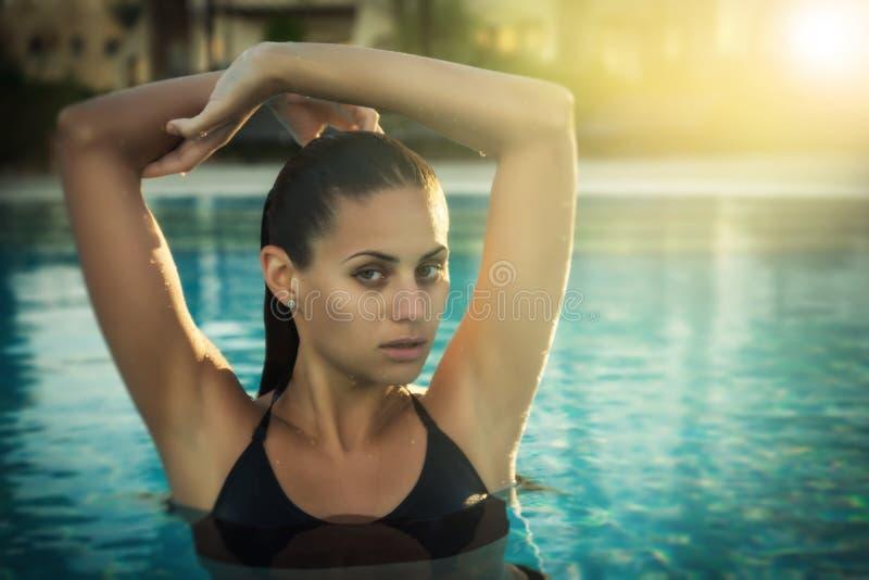 Girl-in-swimming-pool royalty free stock image